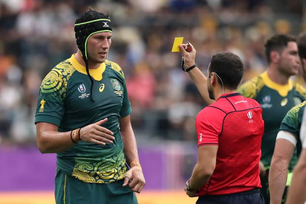 Rugby Union - Rugby World Cup 2019 - Pool D - Australia v Uruguay - Oita Stadium, Oita, Japan - October 5, 2019 Australia's Adam Coleman is shown a yellow card by referee Mathieu Raynal REUTERS/Peter Cziborra