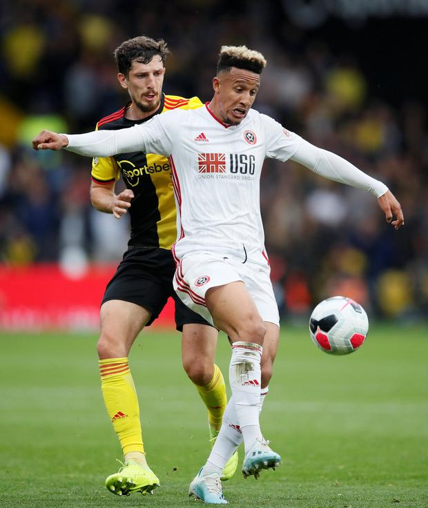 Sheffield United's Callum Robinson in action with Watford's Craig Cathcart