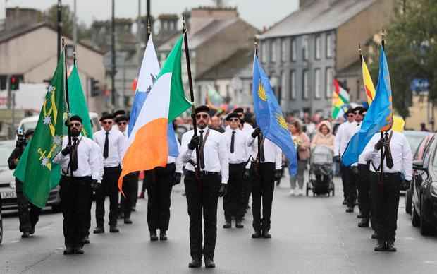 A colour party at the start of a parade in Newry, Co Down. The political party Saoradh had organised the parade to commemorate hunger strikes. Photo: Brian Lawless/PA Wire