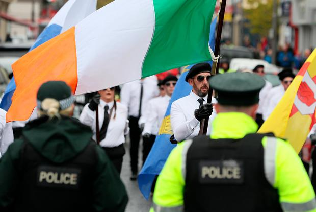 PSNI officers watch as a colour party takes part in a parade in Newry, Co Down. The political party Saoradh had organised the parade to commemorate hunger strikes. Photo: Brian Lawless/PA Wire