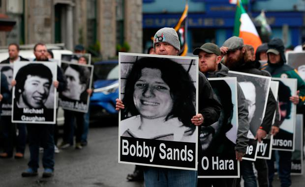People holding placards with pictures and the names of hunger strikers at a parade in Newry, Co Down. The political party Saoradh had organised the parade to commemorate hunger strikes. Photo: Brian Lawless/PA Wire