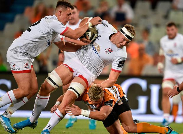 Matthew Rea of Ulster is tackled by Tian Schoeman of Toyota Cheetahs