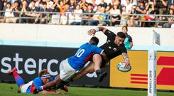 New Zealand's scrum-half TJ Perenara scores a try during the Japan 2019 Rugby World Cup Pool B match between New Zealand and Namibia at the Tokyo Stadium in Tokyo on October 6, 2019. (Photo by Odd ANDERSEN / AFP) (Photo by ODD ANDERSEN/AFP via Getty Images)