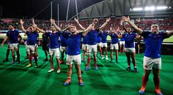 France's players celebrate with fans after winning the Japan 2019 Rugby World Cup Pool C match between France and Tonga at the Kumamoto Stadium in Kumamoto on October 6, 2019. (Photo by FRANCK FIFE / AFP) (Photo by FRANCK FIFE/AFP via Getty Images)