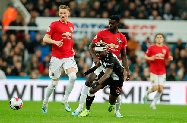 Allan Saint-Maximin of Newcastle United is fouled by Axel Tuanzebe of Manchester United during the Premier League match between Newcastle United and Manchester United at St. James Park on October 06, 2019 in Newcastle upon Tyne, United Kingdom. (Photo by Ian MacNicol/Getty Images)
