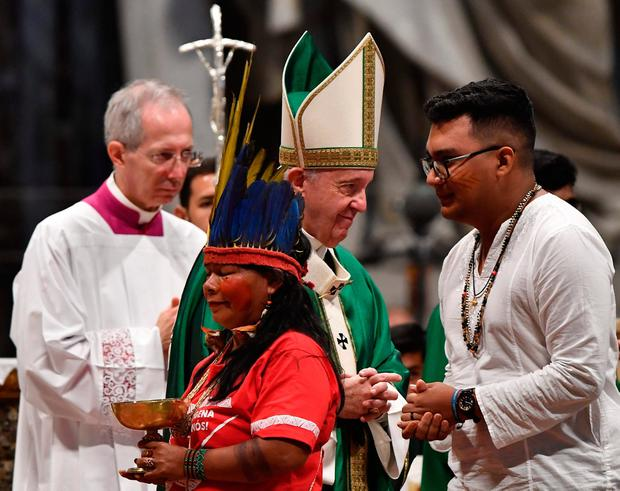 Call for change: Members of the Amazon Rainforest's ethnic groups at Pope Francis's Mass at St Peter's Basilica yesterday. Photo: TIZIANA FABI/AFP via Getty Images