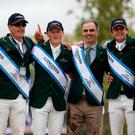 Paul O'Shea, Peter Moloney, team manager Rodrigo Pessoa, Darragh Kenny and Cian O'Connor of Ireland celebrate on the podium. Photo: Linnea Rheborg/Getty Images