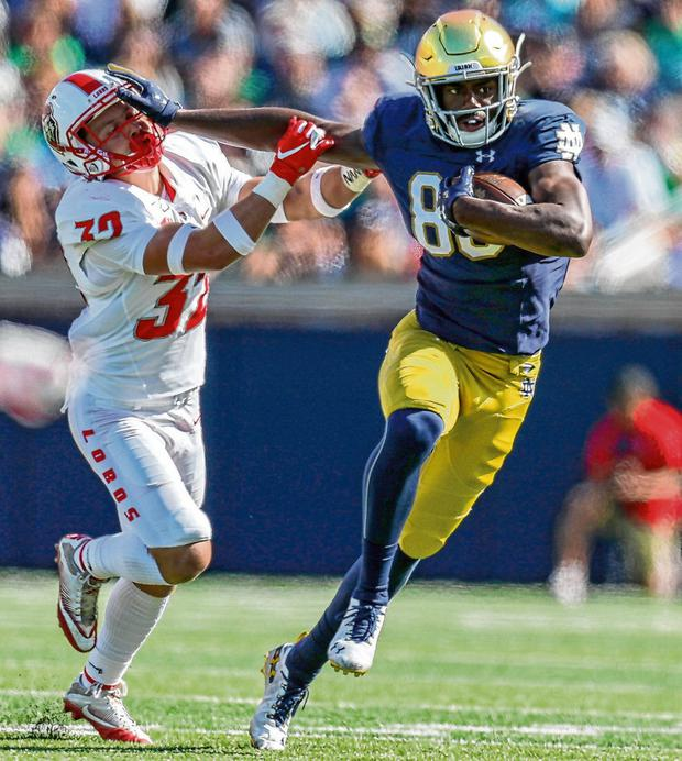 Notre Dame wide receiver Javon McKinley hands off New Mexico Lobos safety Johnny Hernandez during the Fighting Irish's first home game of the season last month. Photo: Frank Jansky/Icon Sportswire via Getty Images