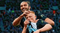 Andy Carroll congratulates Newcastle goalscorer Matty Longstaff after his match-winning goal. Photo: Ian MacNicol/Getty Images