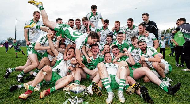 Killoe Emmet Óg players celebrate with the trophy after yesterday's Longford SFC final. Photo: Laszlo Geczo/INPHO