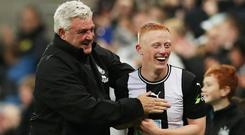 Newcastle United manager Steve Bruce celebrates with Matthew Longstaff after the match. Photo: Scott Heppell/Reuters
