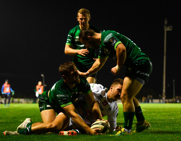 Kyle Godwin of Connacht celebrates after scoring his side's first try with team-mates Caolin Blade and Conor Fitzgerald. Photo: Harry Murphy/Sportsfile