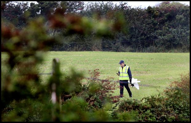 A member of the Air Accident Investigation Unit close to the scene of the fatal aircraft crash near Duncormick in Co Wexford. Pic Steve Humphreys