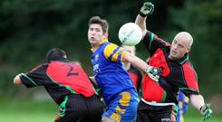 Peadar Heffron (right) pictured playing gaelic football for the PSNI