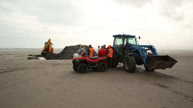 The fin whale being buried on Dollymount Strand. Picture: Mick Carolan