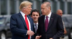 Talks: Turkish President Recep Tayyip Erdogan said the withdrawal of US troops began soon after a phone call with US President Donald Trump. Photo: AP Photo/Pablo Martinez Monsivais