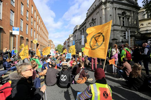 Call to action: Extinction Rebellion protesters outside Government Buildings in Dublin yesterday. Photos: Gerry Mooney