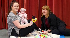 Shauna O'Neill, and her daughter Elise (12 weeks), Ringsend, Dublin do a favour for the Irish Independent and help to demonstrate benefits of the playmat with her friend Marion Byrne. Photo: Damien Eagers