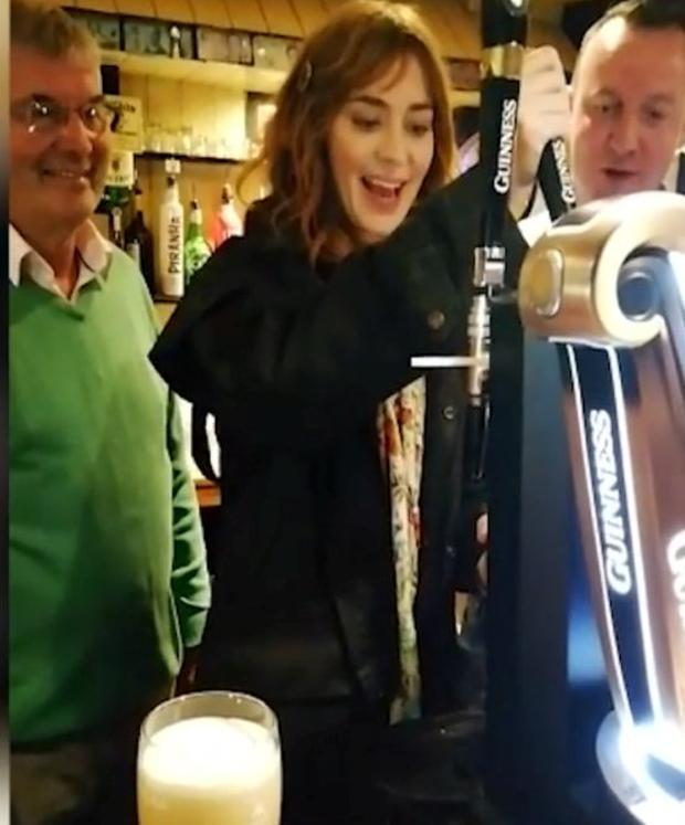 Emily Blunt has a crack at pouring a pint of Guinness in Mayo