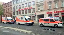 First responders attend to the scene after a fatal shooting in Halle, Germany October 9, 2019. Nonstopnews/Reuters TV via REUTERS .