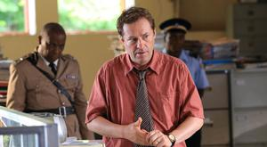 Ardal O'Hanlon is leaving his role as detective Jack Mooney in Death In Paradise (Denis Guyenon/BBC)