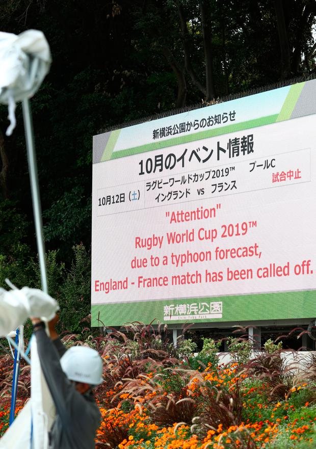 A sign outside of the Yokohama Stadium informs of the cancellation of the England v France game due to Typhoon Hagibis forecast for saturday as workmen take down the temporary tenting during the Rugby World Cup on October 10, 2019 in Yokohama, Japan. (Photo by Stu Forster/Getty Images)