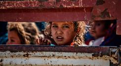 Refugees: Syrian Arab and Kurdish children arrive at Tal Tamr, north west Syria, after fleeing the Turkish assault. Photo: DELIL SOULEIMAN/AFP via Getty Images