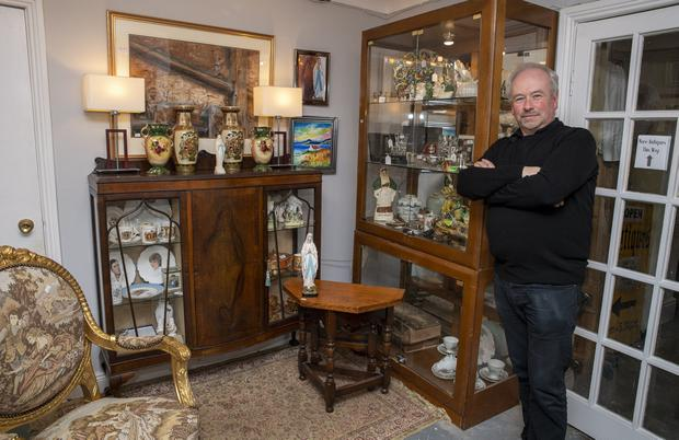 Holy cabinet: Owner of the shop Tom O'Connell in his premises in Tralee, Co Kerry. Photos: Domnick Walsh © Eye Focus LTD