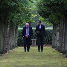 One on one: Boris Johnson and Leo Varadkar walk in the gardens of Thornton Manor, near Liverpool. Photo: Noel Mullen