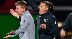 Ireland U-21 boss Stephen Kenny, left, and assistant coach Jim Crawford protest to the referee after Troy Parrott is shown a red card. Photo: Sportsfile