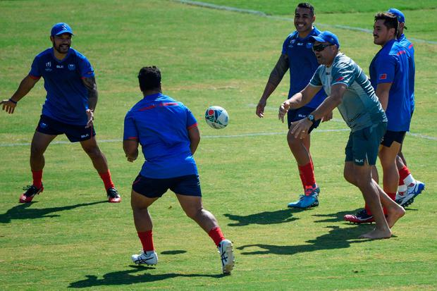 Samoa's head coach Steve Jackson (R) practices with his players during the captain's run training session at the Fukuoka Hakatanomori Stadium in Fukuoka on October 11, 2019, on the eve of the Japan 2019 Rugby World Cup Pool A match between Ireland and Samoa. (Photo by CHRISTOPHE SIMON/AFP via Getty Images)