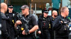 Armed police officers outside the Arndale Centre in Manchester where at least five people have been treated after a stabbing incident. Peter Byrne/PA Wire