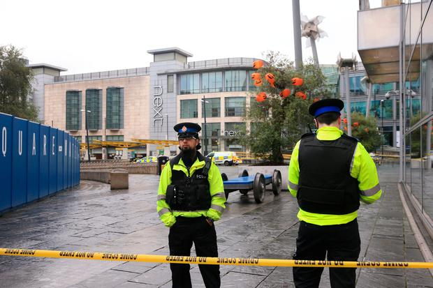 Police outside the Arndale Centre in Manchester where at least four people have been treated after a stabbing incident: Peter Byrne/PA Wire