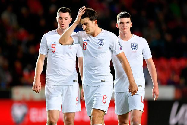 Michael Keane , Harry Maguire and Declan Rice of England look on