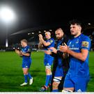 Leinster players, from right, Max Deegan, Scott Fardy, Devin Toner and James Tracy applaud fans