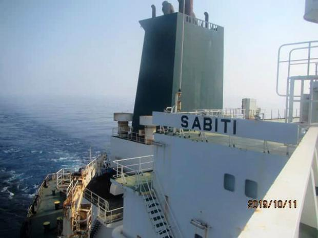 Hit: A photo released by the Iranian Oil Ministry shows oil tanker Sabiti travelling through the Red Sea yesterday. Photo:SHANA via AP