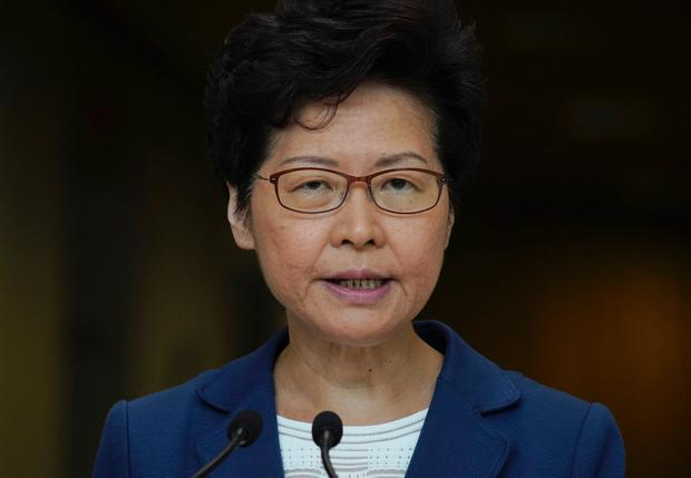 Measure: Hong Kong leader Carrie Lam banned face masks being worn. AP Photo/Vincent Yu
