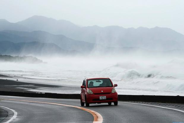 A car goes in front of surging waves as Typhoon Hagibis approaches at a beach in Kumano, Mie prefecture, central Japan Saturday, Oct. 12, 2019. (AP Photo/Toru Hanai)