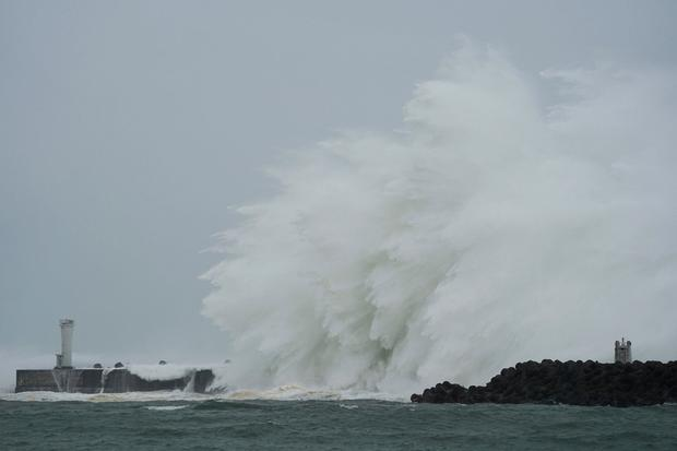 Surging waves hit against the breakwater and a lighthouse as Typhoon Hagibis approaches at a port in town of Kiho, Mie prefecture, central Japan Saturday, Oct. 12, 2019. (AP Photo/Toru Hanai)