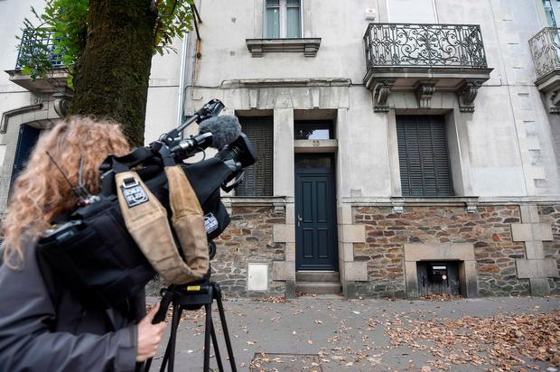A journalist uses a camera to film a house in Nantes, western France on October 12, 2019, the former residence of fugitive Xavier Dupont De Ligonnes, who is suspected of having killed his wife and his four children 8 years ago. (Photo by SEBASTIEN SALOM-GOMIS/AFP via Getty Images)