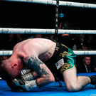 Paddy Barnes is knocked down by Harris