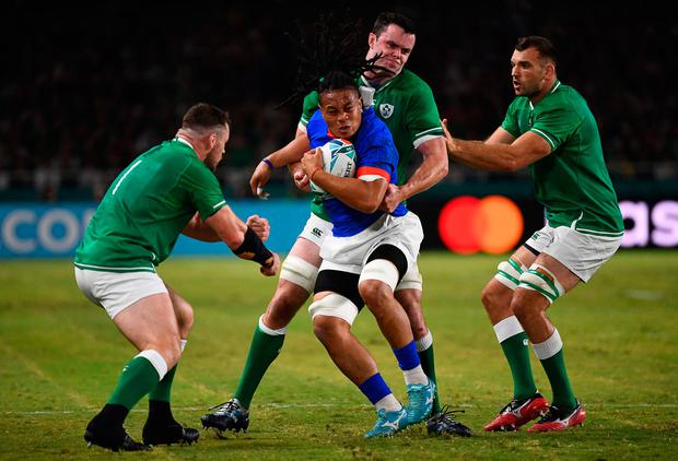 Samoa's flanker TJ Ioane (2L) is tackled by Ireland's Cian Healy (L), James Ryan (2R) and Tadhg Beirne