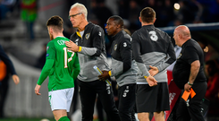 Ireland's Aaron Connolly and manager Mick McCarthy as he comes on as a substitute for James Collins during the Euro 2020 qualifier
