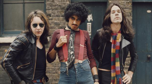 SPREAD THE WORD: Thin Lizzy in 1974, from left, Brian Downey, Phil Lynott (1949-1986) and Gary Moore (1952-2011). Picture: Michael Putland/Getty