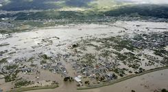 Devastation: An aerial view shows residential areas flooded by the Chikuma river, in Nagano, central Japan. Photo: Kyodo/via REUTERS