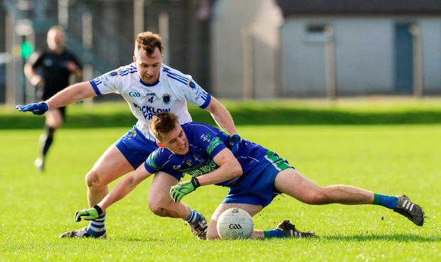 Wayne Doyle of St Patrick's in action against Cathal Kelleher of Arklow Geraldines Ballymoney. Photo: Garry O'Neill/Sportsfile