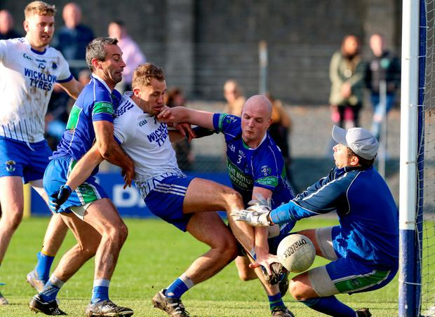Dean Healy of St Patrick's in action against Ciaran Hyland, left, James Tyrrell, centre, and Mervyn Travers of Arklow Geraldines Ballymoney. Photo: Garry O'Neill/Sportsfile