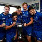 Leinster A players, from left, Ronan Watters, Paddy Patterson, Dan Sheehan, Charlie Ryan and Harry Byrne with the cup following their victory. Photo: Ramsey Cardy/Sportsfile