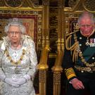 Britain's Queen Elizabeth and Charles, the Prince of Wales are seen during the State Opening of Parliament in the House of Lords Victoria Jones/Pool via REUTERS