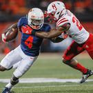 Ricky Smalling, left, of Illinois in action against Nebraska's Dicaprio Bootle at the Memorial Stadium, Illinois last month. Photo: Michael Hickey/Getty Images